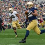 Apr 12, 2014; Notre Dame, IN, USA; Notre Dame Fighting Irish wide receiver C.J. Prosise (20) scores a touchdown in front of linebacker Romeo Okwara (45) in the first quarter of the Blue-Gold game at Notre Dame Stadium. Mandatory Credit: Matt Cashore-USA TODAY Sports