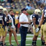Aug 30, 2014; South Bend, IN, USA; Notre Dame Fighting Irish coach Brian Kelly watches his team warm up before the game against the Rice Owls at Notre Dame Stadium. Mandatory Credit: Brian Spurlock-USA TODAY Sports