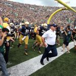 Aug 30, 2014; South Bend, IN, USA; Notre Dame Fighting Irish coach Brian Kelly leads the team onto the field before the game against the Rice Owls at Notre Dame Stadium. Mandatory Credit: Brian Spurlock-USA TODAY Sports