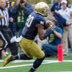 Aug 30, 2014; South Bend, IN, USA; Notre Dame Fighting Irish wide receiver C.J. Prosise (20) scores a touchdown in the second quarter against the Rice Owls at Notre Dame Stadium. Mandatory Credit: Matt Cashore-USA TODAY Sports