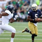 Aug 30, 2014; South Bend, IN, USA; Notre Dame Fighting Irish quarterback Everett Golson (5) runs to the outside against the Rice Owls at Notre Dame Stadium. Mandatory Credit: Brian Spurlock-USA TODAY Sports