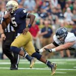 Aug 30, 2014; South Bend, IN, USA; Notre Dame Fighting Irish quarterback Everett Golson (5) runs for a touchdown as Rice Owls defensive tackle Dylan Klare (96) attempts to tackle in the first quarter at Notre Dame Stadium. Mandatory Credit: Matt Cashore-USA TODAY Sports