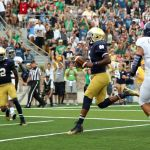 Aug 30, 2014; South Bend, IN, USA; Notre Dame Fighting Irish quarterback Everett Golson (5) runs the ball into the end zone for a touchdown against Rice Owls safety Zach Espinoza (6) at Notre Dame Stadium. Mandatory Credit: Brian Spurlock-USA TODAY Sports
