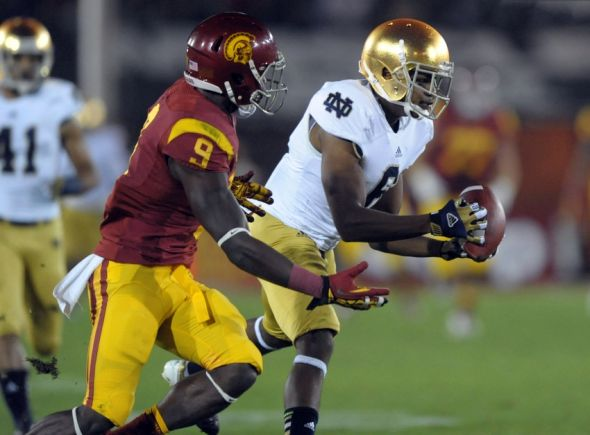 Nov 24, 2012; Los Angeles, CA, USA; Notre Dame Fighting Irish cornerback KeiVarae Russell (6) intercepts a pass intended for Southern California Trojans receiver Marqise Lee (9) at the Los Angeles Memorial Coliseum. Mandatory Credit: Kirby Lee/Image of Sport-USA TODAY Sports