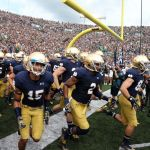 Aug 30, 2014; South Bend, IN, USA; Notre Dame Fighting Irish runs onto the field before the game against the Rice Owls at Notre Dame Stadium. Mandatory Credit: Brian Spurlock-USA TODAY Sports