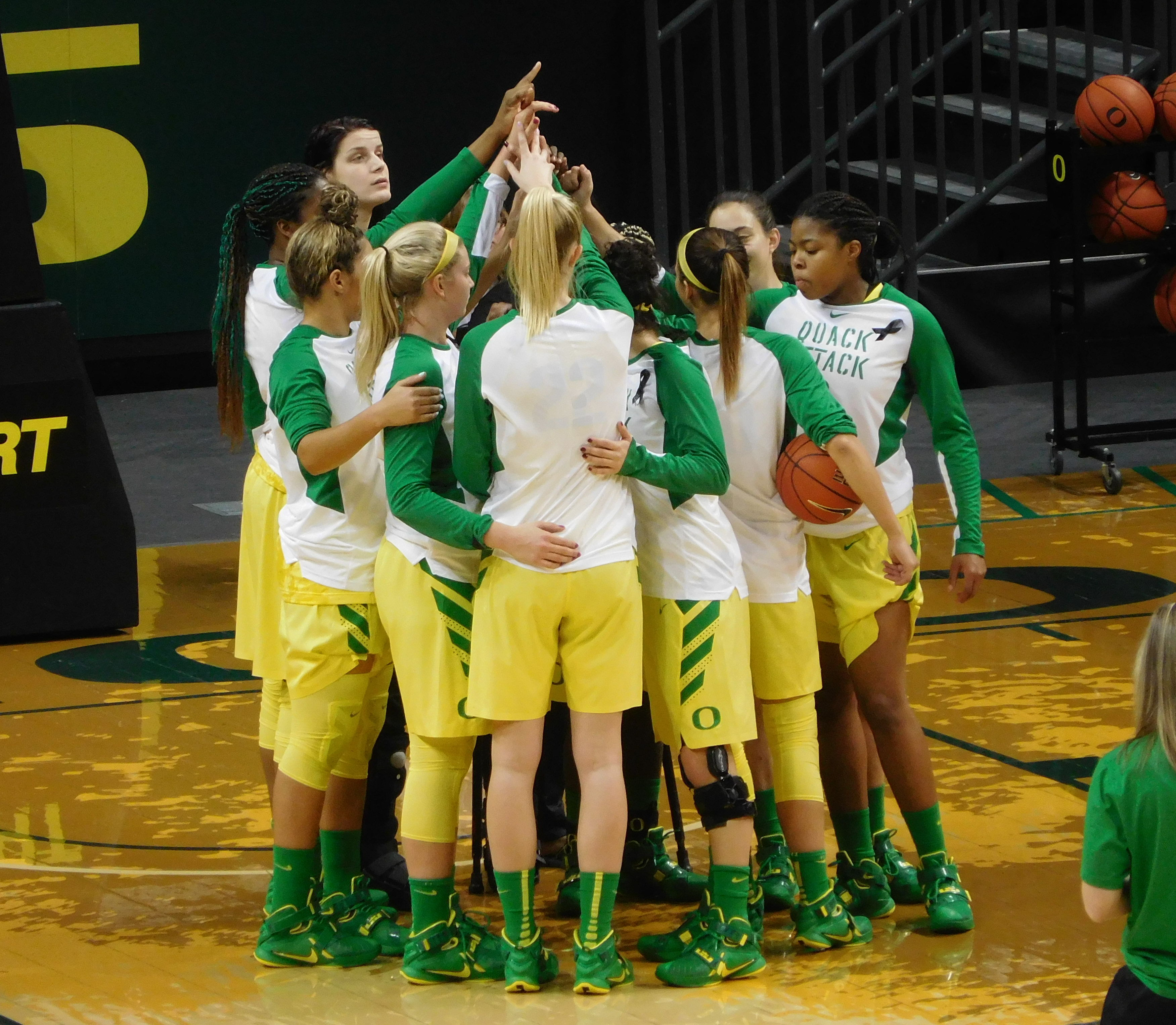 The 2015-16 Oregon Women's Basketball team prepares for a game at Matthew Knight Arena. Justin Phillips/KPNWSports