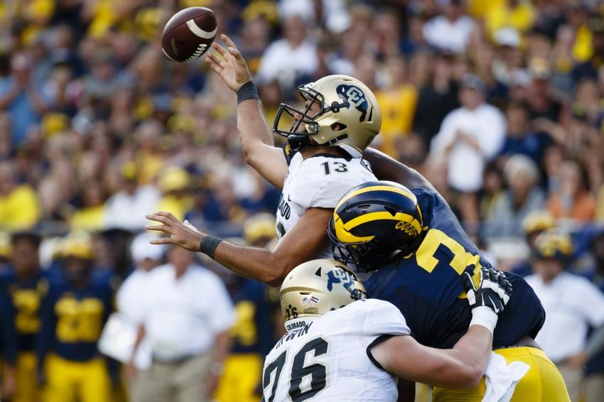 9545727-ncaa-football-colorado-michigan