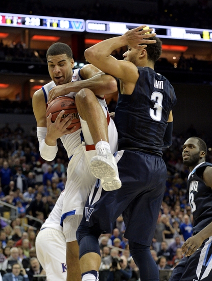 9213579-josh-hart-landen-lucas-ncaa-basketball-ncaa-tournament-south-regional-kansas-vs-villanova