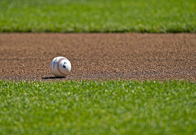 Apr 9, 2012; Minneapolis, MN, USA: A baseball from batting practice lays on the field before a game between the Los Angeles Angels and Minnesota Twins at Target Field. Mandatory Credit: Jesse Johnson-USA TODAY Sports