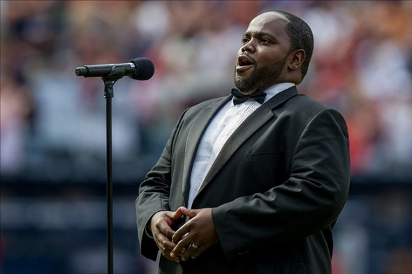 Sep 29, 2013; Atlanta, GA, USA; Atlanta Opera tenor Timothy Miller sings sings God Bless America during the 7th inning stretch during the game between the Atlanta Braves and Philadelphia Phillies at Turner Field. Mandatory Credit: Kevin Liles-USA TODAY Sports