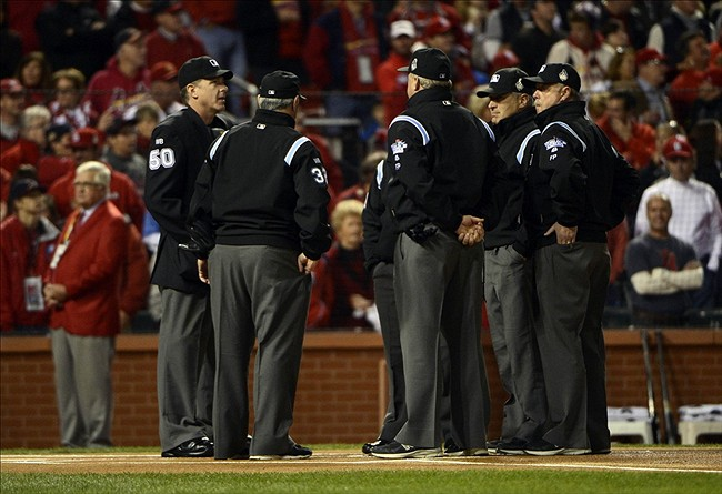 Oct 27, 2013; St. Louis, MO, USA; The umpires gather on the field before game four of the MLB baseball World Series between the St. Louis Cardinals and Boston Red Sox at Busch Stadium. Mandatory Credit: Eileen Blass-USA TODAY Sports