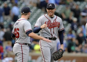 Sep 20, 2013; Chicago, IL, USA; Atlanta Braves pitcher Craig Kimbrel and infielder Freddie Freeman react after their game against the Chicago Cubs at Wrigley Field. Mandatory Credit: Matt Marton-USA TODAY Sports
