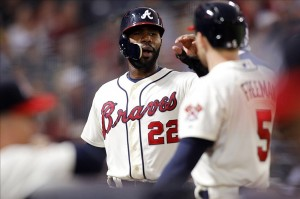 Sep 28, 2013; Atlanta, GA, USA; Atlanta Braves center fielder Jason Heyward (22) is congratulated by first baseman Freddie Freeman (5) after scoring a run against the Philadelphia Phillies in the first inning at Turner Field. Mandatory Credit: Brett Davis-USA TODAY Sports