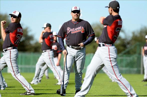 Feb 16, 2014; Lake Buena Vistas, FL, USA; Atlanta Braves manager Fredi Gonzalez talks with pitcher Brandon Beachy (37) during spring training at Champion Stadium. Mandatory Credit: Jonathan Dyer-USA TODAY Sports