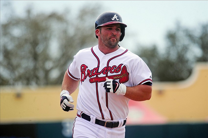 Mar 11, 2014; Lake Buena Vista, FL, USA; Atlanta Braves second baseman Dan Uggla (26) runs the bases after hitting a solo home run in the fifth inning against the Philadelphia Phillies during a spring training exhibition game at Champion Stadium. Mandatory Credit: David Manning-USA TODAY Sports
