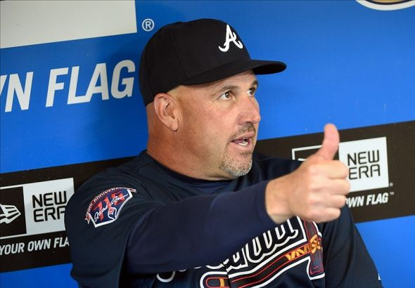 Mar 31, 2014; Milwaukee, WI, USA; Atlanta Braves manager Fredi Gonzalez gives a thumbs up to his players before opening day baseball game against the Milwaukee Brewers at Miller Park. Mandatory Credit: Benny Sieu-USA TODAY Sports