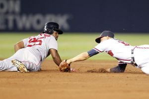 May 27, 2014; Atlanta, GA, USA; Boston Red Sox center fielder Jackie Bradley Jr. (25) slides safely past Atlanta Braves shortstop Andrelton Simmons (19) in the sixth inning at Turner Field. Mandatory Credit: Brett Davis-USA TODAY Sports