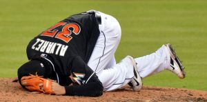 Aug 16, 2014; Miami, FL, USA; Miami Marlins starting pitcher Henderson Alvarez (37) reacts on the pitcher's mound after being hit in the hand. Mandatory Credit: Steve Mitchell-USA TODAY Sports