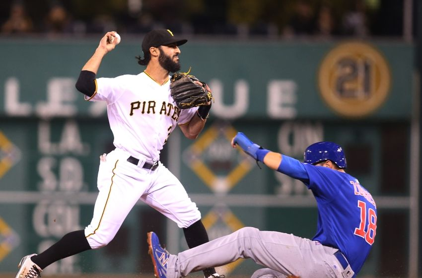 Sep 28, 2016; Pittsburgh, PA, USA; Pittsburgh Pirates shortstop baseman Sean Rodriguez (3) turns a double play over Chicago Cubs second baseman Ben Zobrist (18) during the fourth inning at PNC Park. Mandatory Credit: Charles LeClaire-USA TODAY Sports