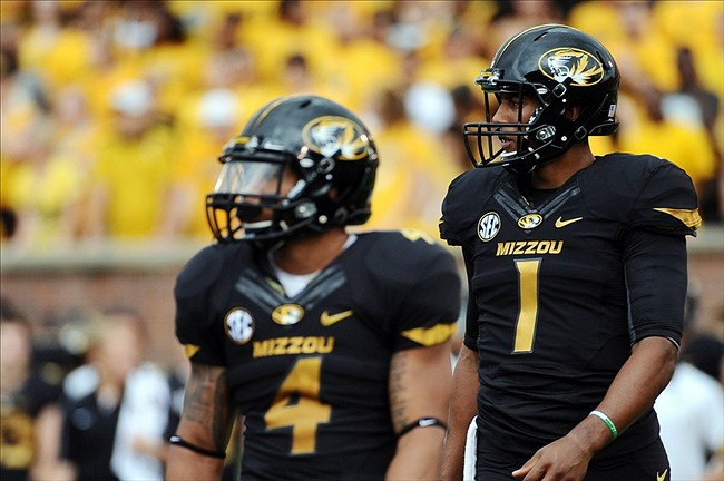 Sept 1, 2012; Columbia, MO, USA; Missouri Tigers quarterback James Franklin (1) and linebacker Kendial Lawrence (4) take the field against the Southeastern Louisiana Lions during the first quarter at Faurot Field. Mandatory Credit: Dak Dillon-US PRESSWIRE