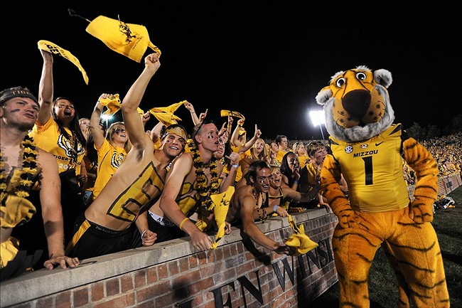 September 8, 2012; Columbia, MO, USA; The Missouri Tigers mascot Truman the Tiger cheers with students in the students section, tigers lair, during the second half at Faurot Field. The Georgia Bulldogs defeated the Missouri Tigers 41-20. Mandatory Credit: Dak Dillon-US PRESSWIRE