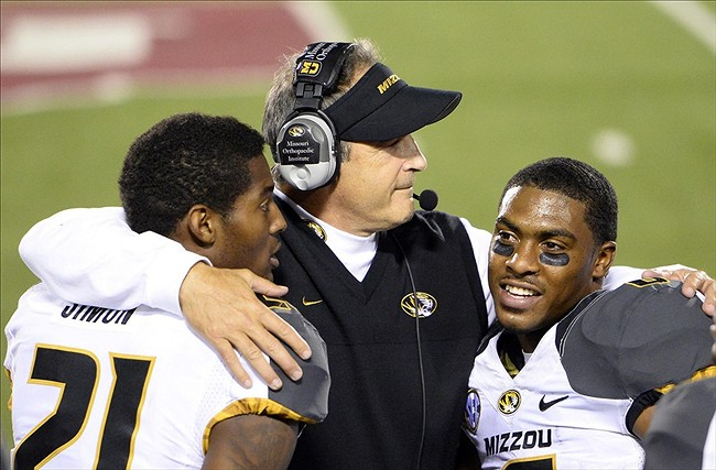 Sep 21, 2013; Bloomington, IN, USA; Missouri Tigers head coach Gary Pinkel reacts with wide receiver Bud Sasser (21) and running back Marcus Murphy (6) during the second half at Memorial Stadium. Missouri defeats Indiana 45-28. Mandatory Credit: Mike DiNovo-USA TODAY Sports