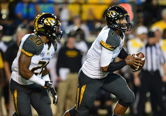 Oct 5, 2013; Nashville, TN, USA; Missouri Tigers quarterback James Franklin (1) runs with the ball against the Vanderbilt Commodores during the first half at Vanderbilt Stadium. Mandatory Credit: Don McPeak-USA TODAY Sports