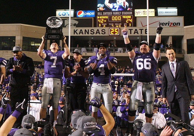 Dec 1, 2012; Manhattan, KS, USA; Kansas State Wildcats quarterback Collin Klein (7) holds up the Big 12 Championship trophy following a 42-24 win over the Texas Longhorns at Bill Snyder Family Stadium. Mandatory Credit: Scott Sewell-USA TODAY Sports