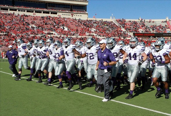 Nov 9, 2013; Lubbock, TX, USA; The Kansas State Wildcats enter the field against the Texas Tech Red Raiders