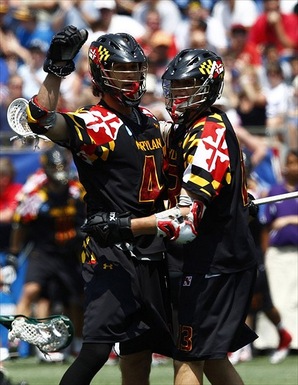 May 28, 2012; Foxborough, MA, USA; Maryland Terrapins midfield Kevin Cooper (left) and attack Owen Blye (13) celebrate after a goal against the Loyola Greyhounds during the first half of the NCAA Division I Men