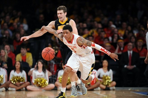 Apr 2, 2013; New York, NY, USA; Iowa Hawkeyes guard Patrick Ingram (24) and Maryland Terrapins guard Nick Faust (5) go after a loose ball during the second half of the NIT Tournament semifinal at Madison Square Garden. Iowa won the game 71-60. Mandatory Credit: Joe Camporeale-USA TODAY Sports
