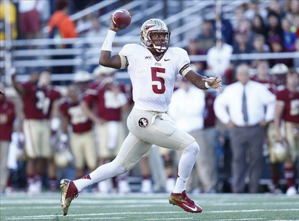 Sep 28, 2013; Boston, MA, USA; Florida State Seminoles quarterback Jameis Winston (5) runs the ball against the Boston College Eagles during the first half at Alumni Stadium. Mandatory Credit: Mark L. Baer-USA TODAY Sports