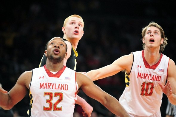 Apr 2, 2013; New York, NY, USA; Maryland Terrapins guard/forward Dez Wells (32), forward Aaron White (30), and Maryland Terrapins guard/forward Jake Layman (10) look up at a rebound during the second half of the NIT Tournament semifinal at Madison Square Garden. Iowa won the game 71-60. Mandatory Credit: Joe Camporeale-USA TODAY Sports