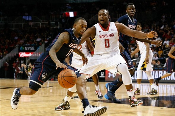 Nov 8, 2013; Brooklyn, NY, USA; Connecticut Huskies guard Ryan Boatright (11) drives around Maryland Terrapins forward Charles Mitchell (0) at Barclays Center. Connecticut Huskies won 78-77. Mandatory Credit: Anthony Gruppuso-USA TODAY Sports