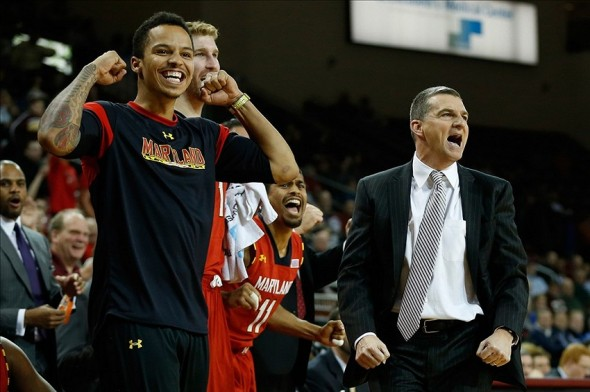 Dec 12, 2013; Chestnut Hill, MA, USA; Maryland Terrapins guard Seth Allen (left) and head coach Mark Turgeon react in the final seconds of the game against the Boston College Eagles at Silvio O. Conte Forum. Maryland Terrapins won 88-80. Mandatory Credit: Greg M. Cooper-USA TODAY Sports