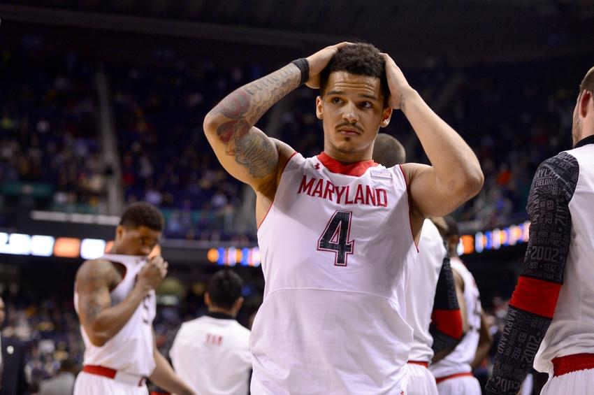 Mar 13, 2014; Greensboro, NC, USA; Maryland Terrapins guard Nick Faust (5) and guard Seth Allen (4) react after the game. The Seminoles defeated the Terrapins 67-65 in the second round of the ACC college basketball tournament at Greensboro Coliseum. Mandatory Credit: Bob Donnan-USA TODAY Sports