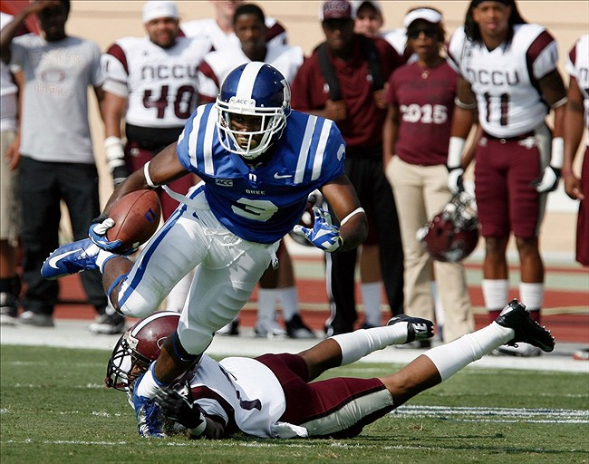 Aug 31, 2013; Durham, NC, USA; Duke Blue Devils wide receiver Jamison Crowder (3) escapes from the grip of North Carolina Central Eagles defensive back Cameron Hughes (17) at Wallace Wade Stadium. Mandatory Credit: Mark Dolejs-USA TODAY Sports