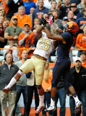 Oct 11, 2014; Syracuse, NY, USA; Florida State Seminoles defensive back P.J. Williams (26) and Syracuse Orange wide receiver Steve Ishmael (8) grab a pass in the end zone that would fall incomplete during the second quarter at the Carrier Dome. Florida State defeated Syracuse 38-20. Mandatory Credit: Rich Barnes-USA TODAY Sports