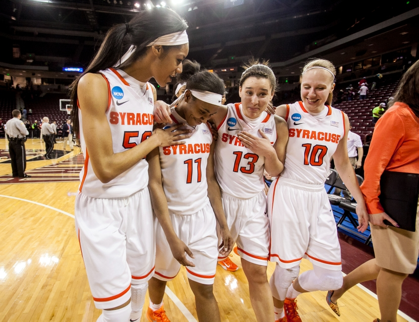 Mar 20, 2015; Columbia, SC, USA; Syracuse Orange center Briana Day (50) and guard Cornelia Fondren (11) and guard Brianna Butler (13) and forward Isabella Slim (10) celebrate their win over the Nebraska Cornhuskers in the first round of the women