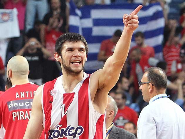Kostas Papanikolaou will stay overseas this season after the Rockets acquired the rights to him in June 2013.