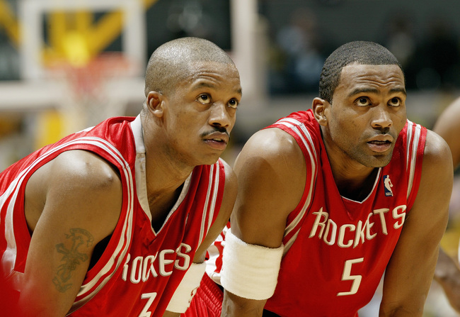 Cuttino Mobley and Steve Francis watches a free throw attempt as members of the Houston Rockets. (circa 2004)