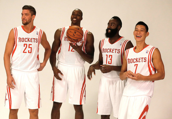 Chandler Parsons, Dwight Howard, James Harden, and Jeremy Lin pose for Houston Rockets media day (9-27-13)