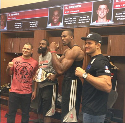 From left: UFC heavyweight champion Cain Velasquez, James Harden, Dwight Howard and Junior dos Santos pose for a photo in the Rockets locker room on Thursday. (Photo courtesy of UFC and Getty Images)