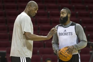Hakeem Olajuwon, working with James Harden earlier in the week. (Smiley N. Pool / Houston Chronicle)