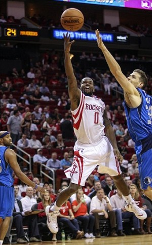 Nov 1, 2013; Houston, TX, USA; Houston Rockets point guard Aaron Brooks (0) scores a basket during the second quarter against the Dallas Mavericks at Toyota Center. Mandatory Credit: Troy Taormina-USA TODAY Sports