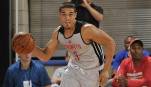 Rookie Nick Johnson handles the ball for the Rockets in Orlando Summer League action on July 10th, 2014. Photo Credit - Turner Sports