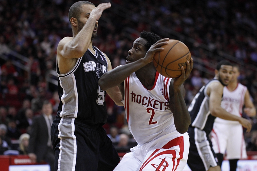 Jan 28, 2014; Houston, TX, USA; Houston Rockets point guard Patrick Beverley (2) is defended by San Antonio Spurs point guard Tony Parker (9) during the fourth quarter at Toyota Center. Mandatory Credit: Andrew Richardson-USA TODAY Sports