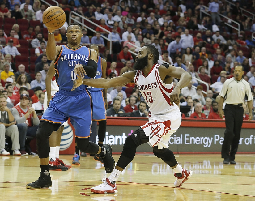 Nov 2, 2015; Houston, TX, USA; Oklahoma City Thunder guard Russell Westbrook (0) passes against Houston Rockets guard James Harden (13) in the third quarter at Toyota Center. Rocket won 110 to 105. Mandatory Credit: Thomas B. Shea-USA TODAY Sports