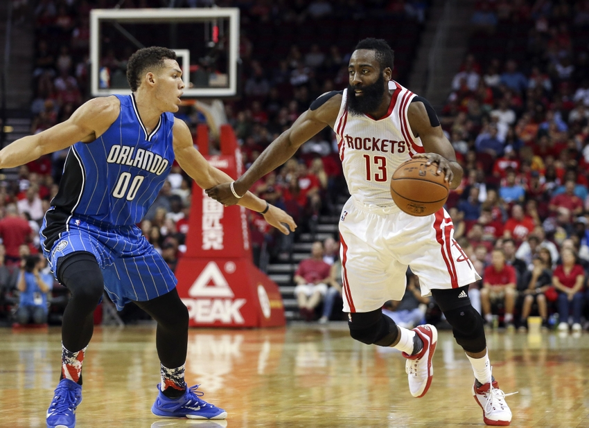 Nov 4, 2015; Houston, TX, USA; Houston Rockets guard James Harden (13) drives the ball as Orlando Magic forward Aaron Gordon (00) defends during the second quarter at Toyota Center. Mandatory Credit: Troy Taormina-USA TODAY Sports