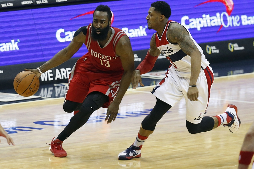 Dec 9, 2015; Washington, DC, USA; Houston Rockets guard James Harden (13) dribbles the ball as Washington Wizards guard Bradley Beal (3) defends in the third quarter at Verizon Center. The Rockets won 109-103. Mandatory Credit: Geoff Burke-USA TODAY Sports